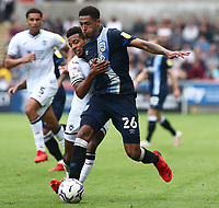 25th September 2021; Swansea.com Stadium, Swansea, Wales; EFL Championship football, Swansea versus Huddersfield; Levi Colwill of Huddersfield Town and Korey Smith of Swansea City challenge for the ball