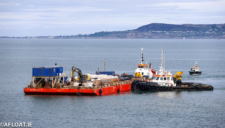 The multi-role marine platform is positioned into place at Dun Laoghaire Baths by tugs Sarah Grey and AMS Retriever