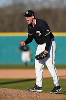 Pitcher Austin Morgan (10) of the University of South Carolina Upstate Spartans shouts and pumps his fist after recording the final out and earning a save in a 5-1 win against the University of Toledo Rockets on Saturday, February 20, 2021, at Cleveland S. Harley Park in Spartanburg, South Carolina. (Tom Priddy/Four Seam Images)