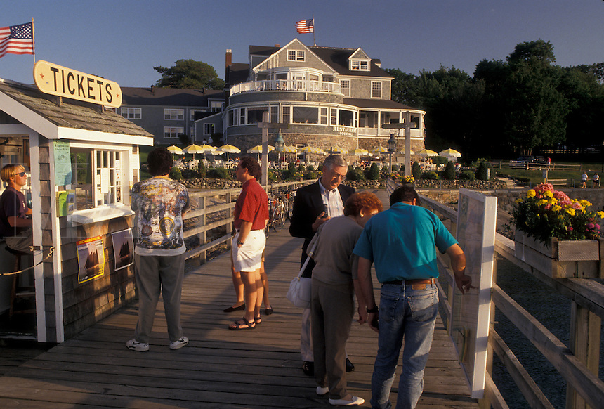 AJ4488, Bar Harbor, ticket booth, Maine, Atlantic Ocean, People waiting to buy tickets on the pier for a boat tour in the scenic seaside town of Bar Harbor on Mount Desert Island in the state of Maine.