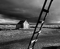 Outbuilding and ladder with storm clouds. Summer Lake State Wildlife Refuge, Oregon