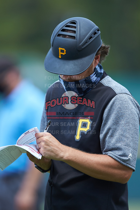 Pittsburgh Pirates scout Adam Bourassa makes notes while coaching first base during the East Coast Pro Showcase at the Hoover Met Complex on August 3, 2020 in Hoover, AL. (Brian Westerholt/Four Seam Images)