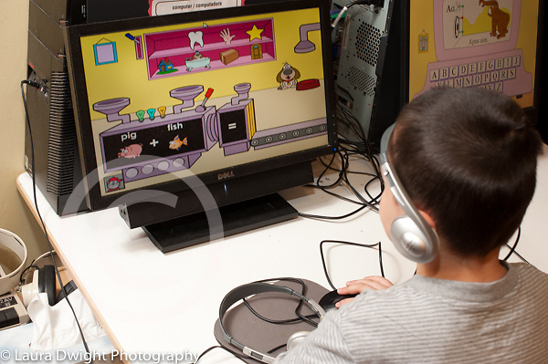 Education Preschool 3-4 year olds boy using computer to play educational game