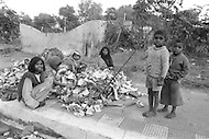 Children collecting garbage in India  - Child labor as seen around the world between 1979 and 1980 – Photographer Jean Pierre Laffont, touched by the suffering of child workers, chronicled their plight in 12 countries over the course of one year.  Laffont was awarded The World Press Award and Madeline Ross Award among many others for his work.