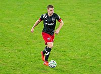 WASHINGTON, DC - NOVEMBER 8: Julian Gressel #31 of D.C. United dribbles during a game between Montreal Impact and D.C. United at Audi Field on November 8, 2020 in Washington, DC.