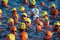 triathletes at the Ironman Triathlon, 2.4 miile swim, 112 mile bike, 26.2 mile run, Big Island, Hawaii, Pacific Ocean
