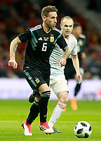 Spain's Andres Iniesta (r) and Argentina's Lucas Biglia during international friendly match. March 27,2018. *** Local Caption *** © pixathlon<br /> Contact: +49-40-22 63 02 60 , info@pixathlon.de