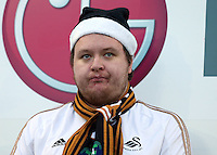 A Swansea City fan wearing a Christmas hat during the Barclays Premier League match between Swansea City and West Ham United played at The Liberty Stadium, Swansea on 20th December 2015
