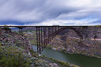 The I. B. Perrine Bridge carries US Highway 93 traffic over the Snake River Canyon in Twin Falls, ID. The 1500 foot long four-lane truss arch was completed in July of 1976 and replaced an earlier span that had become outdated. The bridge is named for I. B. Perrine (1861–1943), who spearheaded early 20th century irrigation projects in the Magic Valley region and is largely credited as being the main founder of Twin Falls.
