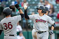 Kyle Higashioka (66) of the Scranton/Wilkes-Barre RailRiders is greeted at the plate by teammate Mike Ford (36) after hitting a home run at Victory Field on May 14, 2019 in Indianapolis, Indiana. The Indians defeated the RailRiders 4-2. (Andrew Woolley/Four Seam Images)