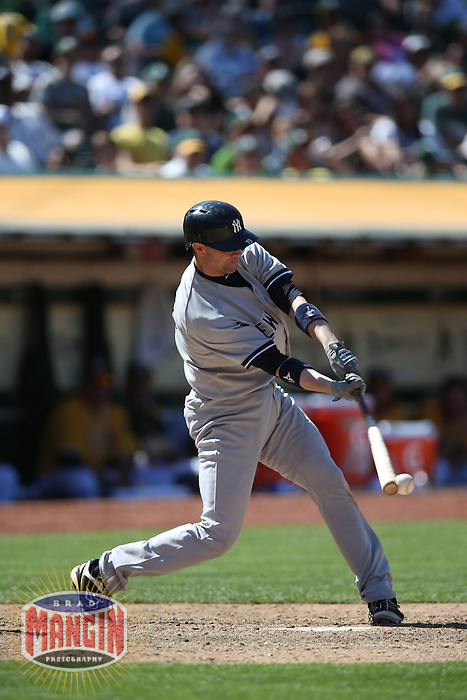 OAKLAND, CA - JUNE 13:  Chris Stewart #19 of the New York Yankees bats against the Oakland Athletics during the game at O.co Coliseum on Thursday June 13, 2013 in Oakland, California. Photo by Brad Mangin