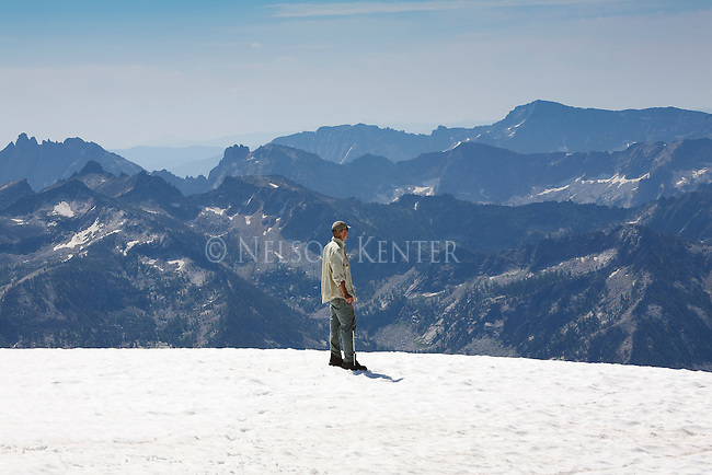 Standing on snow at the summit of El Capitan peak some 3000 feet above base camp at Kerlee Lake in the Bitterroot Mountains in Montana