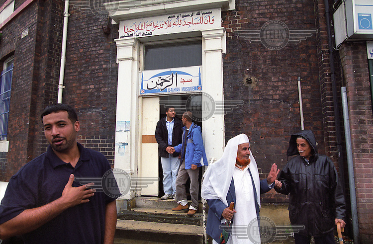Yemeni men leaving Friday prayers at the Al-Rahman Mosque, housed in the former Burngreave Library on Ellesmere Green in Burngreave in Sheffield.