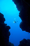 Diver Exploring Yap Caverns, a maze of natural tunnels winding through a shallow reef, Yap, Micronesia, Pacific Ocean (MR)
