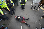 © Joel Goodman - 07973 332324 - all rights reserved . 03/06/2017 . Liverpool , UK . A woman lies in the road and blocks the EDL march from progressing , outside Liverpool Lime Street Station . Hundreds of police manage a demonstration by the far-right street protest movement , the English Defence League ( EDL ) and an demonstration by opposing anti-fascists , including Unite Against Fascism ( UAF ) . Photo credit : Joel Goodman
