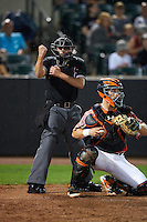Umpire Anthony Perez calls a strike behind catcher Chris Shaw (58) during a game between the Tri-City ValleyCats and Aberdeen Ironbirds on August 6, 2015 at Ripken Stadium in Aberdeen, Maryland.  Tri-City defeated Aberdeen 5-0 as combined to throw a no-hitter.  (Mike Janes/Four Seam Images)