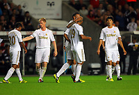 Pictured: Luke Moore of Swansea (C) is congratulated for his goal by team mates. Tuesday 28 August 2012<br /> Re: Capital One Cup game, Swansea City FC v Barnsley at the Liberty Stadium, south Wales.