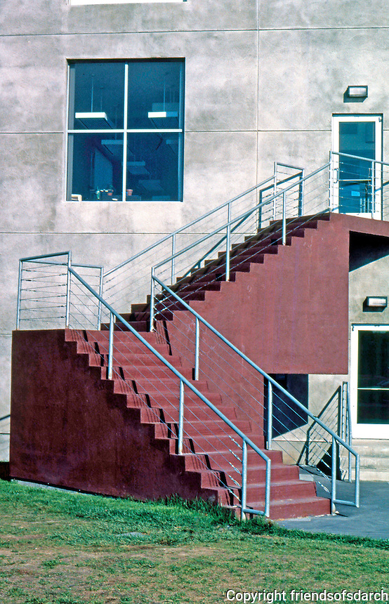 Frank Gehry: ICS/ERF Complex, Irvine 1984. West side of ERF. Detail--stairs and industrial grade railings.  Photo '86.