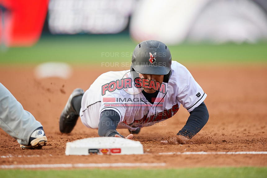 Indianapolis Indians left fielder Chris Bostick (7) dives back to first base on a pickoff attempt throw during a game against the Toledo Mud Hens on May 2, 2017 at Victory Field in Indianapolis, Indiana.  Indianapolis defeated Toledo 9-2.  (Mike Janes/Four Seam Images)