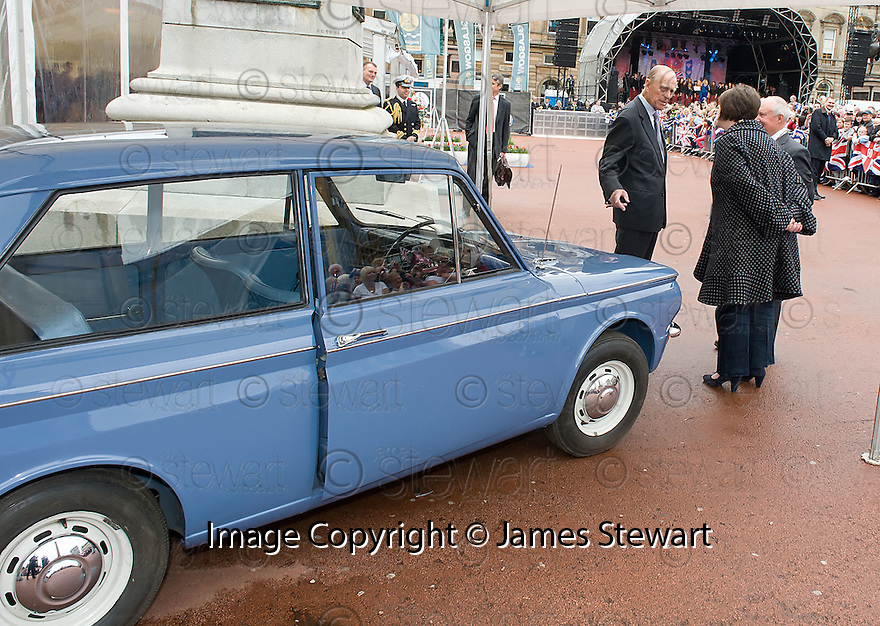 The Duke of Edinburgh is shown the first Hillman Imp to come of the production line as he visits George Square, Glasgow as part of The Queen's Diamond Jubilee Celebrations..