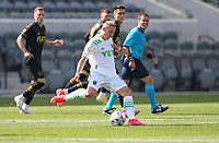 LOS ANGELES, CA - APRIL 17: Alex Ring #8  of Austin FC passes off the ball during a game between Austin FC and Los Angeles FC at Banc of California Stadium on April 17, 2021 in Los Angeles, California.