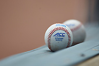 Two ACC baseballs lay on the padding in the game between the Miami Hurricanes and the Georgia Tech Yellow Jackets during game one of the 2017 ACC Baseball Championship at Louisville Slugger Field on May 23, 2017 in Louisville, Kentucky. The Hurricanes walked-off the Yellow Jackets 6-5 in 13 innings. (Brian Westerholt/Four Seam Images)