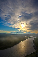 Sunrise over mount Sanford, Drum and wrangell of the Wrangell Mountains, Wrangell St. Elias National Park, Alaska. Copper River in the foreground.