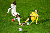 24th March 2021; Leuven, Belgium;  Romelu Lukaku  of Belgium is slide tackled by Joe Morrell  of Wales  during the World Cup Qatar 2022 Qualifiers Match between Belgium and Wales on March 24, 2021 in Leuven, Belgium