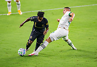 LOS ANGELES, CA - SEPTEMBER 13: Latif Blessing #7 of LAFC attempts to move past Marvin Loría #44 of the Portland Timbers during a game between Portland Timbers and Los Angeles FC at Banc of California stadium on September 13, 2020 in Los Angeles, California.