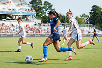 CARY, NC - SEPTEMBER 12: Debinha #10 of the NC Courage dribbles the ball past Christen Westphal #18 of the Portland Thorns during a game between Portland Thorns FC and North Carolina Courage at Sahlen's Stadium at WakeMed Soccer Park on September 12, 2021 in Cary, North Carolina.