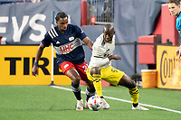 FOXBOROUGH, MA - MAY 16: Bradley Wright-Phillips #99 Columbus SC controls the ball under pressure from Jen Bell #22 of New England Revolution during a game between Columbus SC and New England Revolution at Gillette Stadium on May 16, 2021 in Foxborough, Massachusetts.