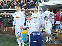 Pictured: Friday 26 December 2014<br /> Re: Premier League, Swansea City FC v Aston Villa at the Liberty Stadium, Swansea, south Wales, UK.<br /> <br /> Gylfi Sigurdsson leaving the tunnel