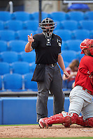 Umpire Mike Savakinas makes a call during the first game of a doubleheader between the Palm Beach Cardinals and Dunedin Blue Jays on July 31, 2015 at Florida Auto Exchange Stadium in Dunedin, Florida.  Dunedin defeated Palm Beach 7-0.  (Mike Janes/Four Seam Images)