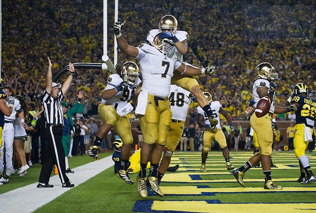 Sept. 7, 2013; Stephon Tuitt (7) celebrates after catching an interception in the end zone for a touchdown in the fourth quarter.<br /> <br /> Photo by Matt Cashore