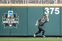 Vanderbilt Commodores outfielder Stephen Scott (19) makes a catch during Game 8 of the NCAA College World Series against the Mississippi State Bulldogs on June 19, 2019 at TD Ameritrade Park in Omaha, Nebraska. Vanderbilt defeated Mississippi State 6-3. (Andrew Woolley/Four Seam Images)