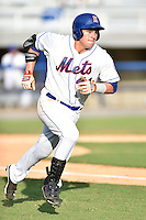 Kingsport Mets third baseman Eudor Garcia #44 runs to first during a game against the Johnson City Cardinals at Hunter Wright Stadium August 24, 2014 in Kingsport, Tennessee. The Mets defeated the Cardinals 9-1. (Tony Farlow/Four Seam Images)