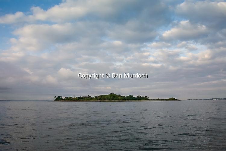 Cockenoe Island in Westport, CT under puffy white clouds
