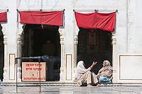 India, Dehradun.  Two Women Talking  at the Entrance to the Sikh Temple Durbar Shri Guru Ram Rai Ji Maharaj, built in 1707.