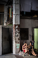 Havana, Cuba, sept 2014.  People who lost their homes that collapsed after a barrage living in a parking lot in downtown Havana.                             In recent years, Raul Castro has made several economic measures for the people of the island. Cubans can now buy and sell apartments or cars, can stay in hotels on the island and can travel abroad with minor difficulties. Most of the global economists believe that these changes are moving in the right direction but its positive effects on people are very slow. Cubans continue to struggle daily through the streets of Havana with humor and zest for life.                                  En los ultimos años Raul Castro ha realizado varias medidas economicas para el pueblo de la isla. Ahora los cubanos pueden comprar y vender departamentos o coches, pueden alojarse en hoteles de la isla y pueden viajar al extranjero con menores dificultades. La mayor parte de los economistas mundiales consideren que estos cambios se mueven en la justa direccion pero sus efectos positivos sobre la gente son muy lentos. Los cubanos siguen luchando a diario por las calles de La Habana con humorismo y ganas de vivir.
