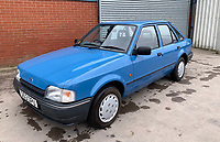 BNPS.co.uk (01202 558833)<br /> Pic: HampsonAuctions/BNPS<br /> <br /> Pictured: 1990 Ford Escort 1.3 Popular.<br /> <br /> Since the 1990s, Geoff Barlow, 46, has collected dozens of classic cars from an Escort Mexico replica to several types of Transit, Cortina, and Sierra.<br /> <br /> However, he still regrets selling the first car which inspired his passion, a 1980 Escort Mark 2 he bought from his sister in 1992.  <br /> <br /> Geoff's fascination with Fords gathered pace in the last decade and he 'lost control,' buying as many Fords as he came across and saving them from disrepair.