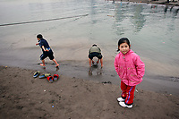 CHINA. Sichuan Province. Chongqing. Children playing in The Yangtze River which is at its lowest level in 150 years as a result of a country-wide drought. Chongqing is a city of over 3,000,000 people, famed for being the capital of China between 1938 and 1946 during World War II. It is situated on the banks of the Yangtze river, China's longest river and the third longest in the world. Originating in Tibet, the river flows for 3,964 miles (6,380km) through central China into the East China Sea at Shanghai.  2008