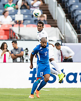 DENVER, CO - JUNE 19: Yosel Piedra #6 goes over Etages Kevin Parsemain #17 for a header during a game between Martinique and Cuba at Broncos Stadium on June 19, 2019 in Denver, Colorado.