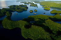 Aerial view of the Rock Islands in the late afternoon Natural Arch Area, Palau, <br /> Micronesia