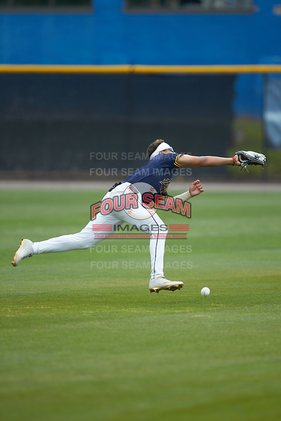 North Carolina A&T Aggies left fielder TJ Ash (13) just misses catching this pop fly during the game against the North Carolina Central Eagles at Durham Athletic Park on April 10, 2021 in Durham, North Carolina. (Brian Westerholt/Four Seam Images)