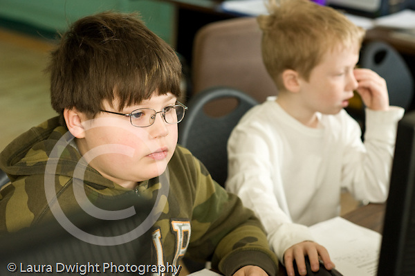 Education Elementary school Grade 2 science special n computer lab two boys using computers for work horizontal