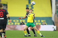 20th April 2021; Carrow Road, Norwich, Norfolk, England, English Football League Championship Football, Norwich versus Watford; Jordan Hugill of Norwich City competes for the ball with Adam Masina of Watford