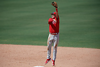 Philadelphia Phillies shortstop Bryson Stott (10) jumps for a high throw in between innings during an Instructional League game against the Toronto Blue Jays on September 17, 2019 at Spectrum Field in Clearwater, Florida.  (Mike Janes/Four Seam Images)