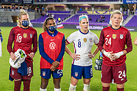 ORLANDO, FL - JANUARY 22: Jane Campbell #18, Catarina Macario #29, Julie Ertz #8 and Jane Campbell #24 of the USWNT listen to Vlatko Andonovski after a game between Colombia and USWNT at Exploria stadium on January 22, 2021 in Orlando, Florida.