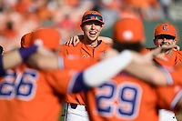 Clemson Tigers players, including Drew Wharton (13), center, form a circle before a game against the William and Mary Tribe on February 16, 2018, at Doug Kingsmore Stadium in Clemson, South Carolina. Clemson won, 5-4 in 10 innings. (Tom Priddy/Four Seam Images)