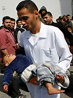 "Palestinian medics carry a baby wounded during an Israeli army operation in the northern Gaza Strip, into hospital in Beit Lahiya, Saturday, March 1, 2008. Thirty-three Gazans, including at least 16 civilians, died in Israeli-Palestinian violence that escalated sharply Saturday, clouding an upcoming peacemaking mission by U.S. Secretary of State Condoleezza Rice. Two children were among those killed in some of the fiercest fighting in the Gaza Strip since Islamic Hamas militants seized control there in June. The latest round of clashes, which began Wednesday, has renewed threats of an Israeli invasion of Gaza to crush militant rocket squads that bombard southern Israel daily.""photo by Fady Adwan"""